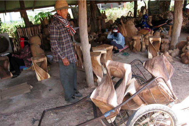 Artisan Loading a Wheelbarrow
